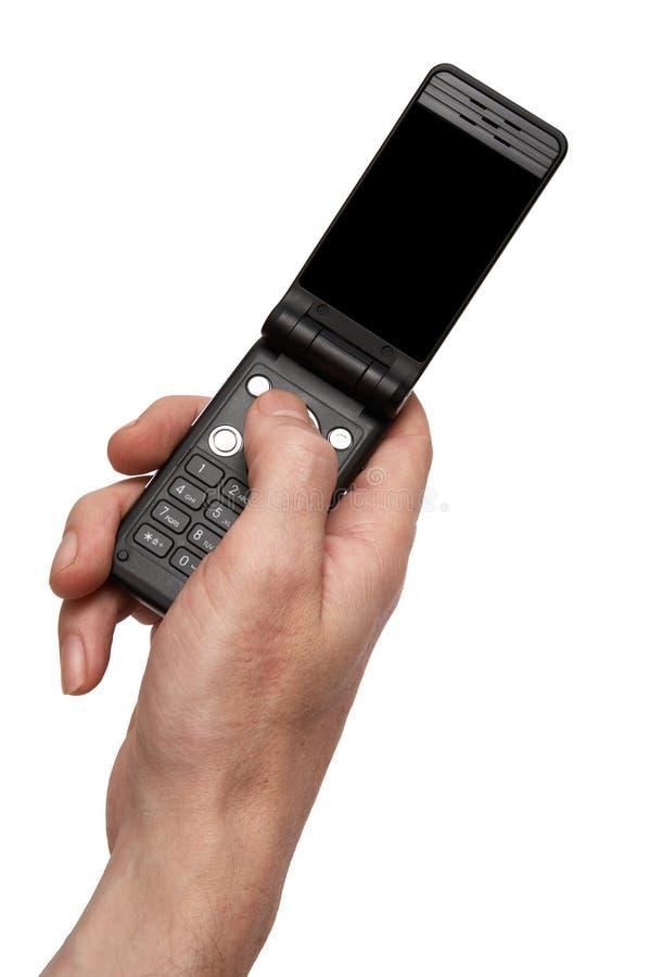 Telefono in una mano immagine stock