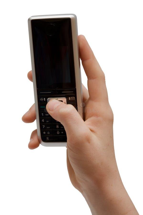 Telefono in una mano immagine stock libera da diritti