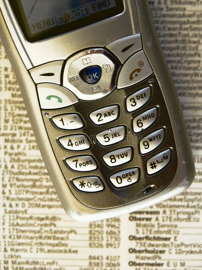 Telefoon en boek royalty-vrije stock afbeelding