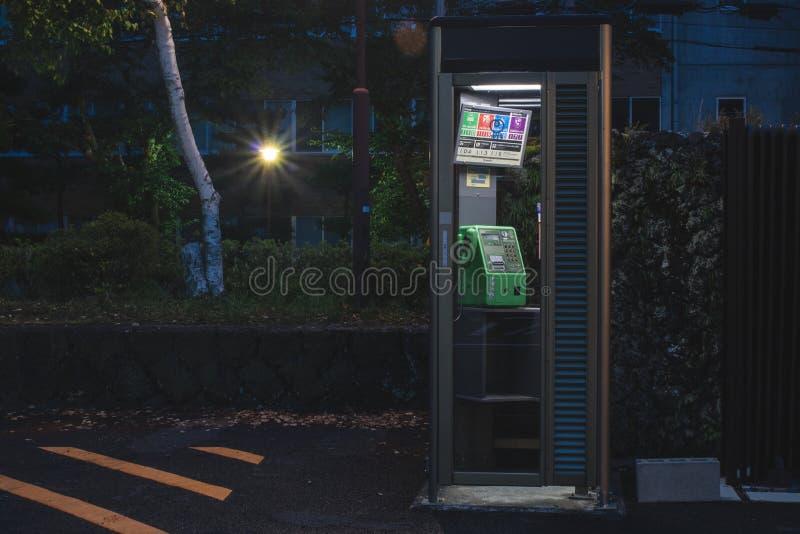 Telefooncel in nacht royalty-vrije stock afbeelding