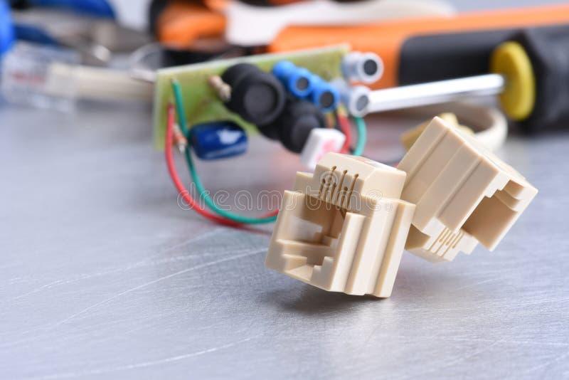 Telefooncontactdoos en hulpmiddelen, het luisteren apparaten voor het spioneren insect stock fotografie
