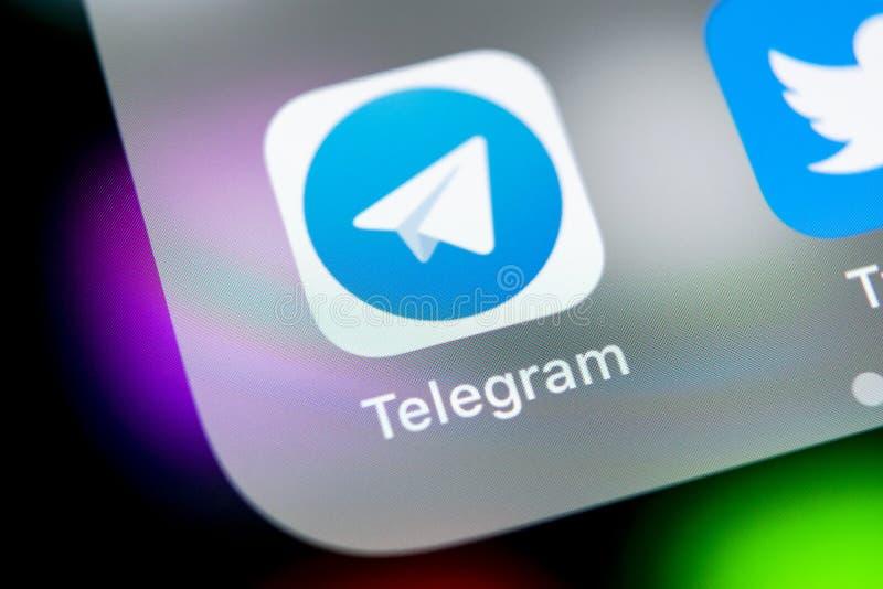 Telegram application icon on Apple iPhone X screen close-up. Telegram app icon. Telegram is an online social media network. Social stock photos