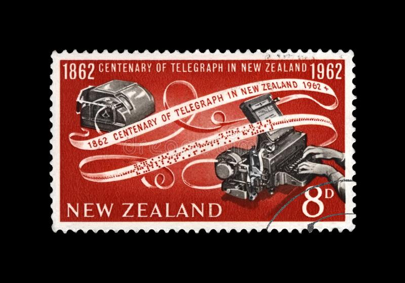 Telegraph device and encoded paper tape, 100th anniversary of inauguration of the telegraph in New Zealand, circa 1962, royalty free stock images