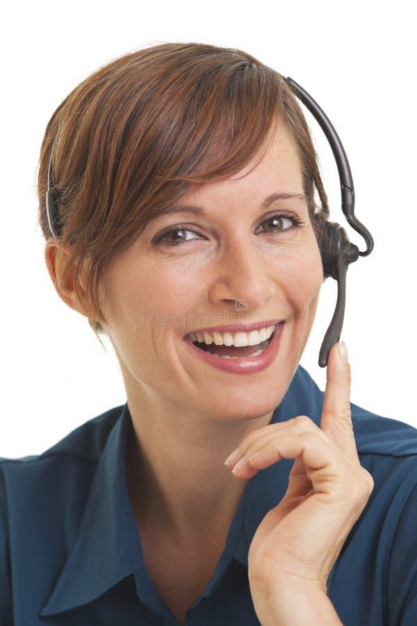 Telemarketer da mulher com mão em auriculares imagens de stock