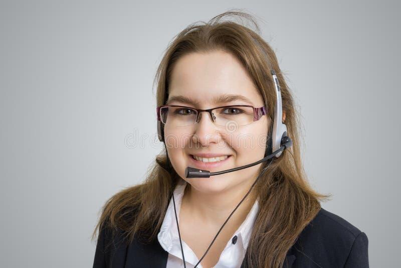 Telemarketing en van de klantendienst concept Jonge glimlachende vrouw - exploitant stock foto's