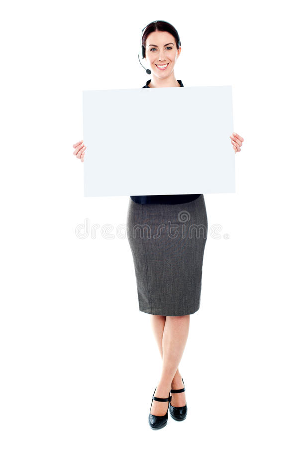 Telemarketing female with blank billboard. Telemarketing femlae holding a blank billboard. Full length portrait royalty free stock images