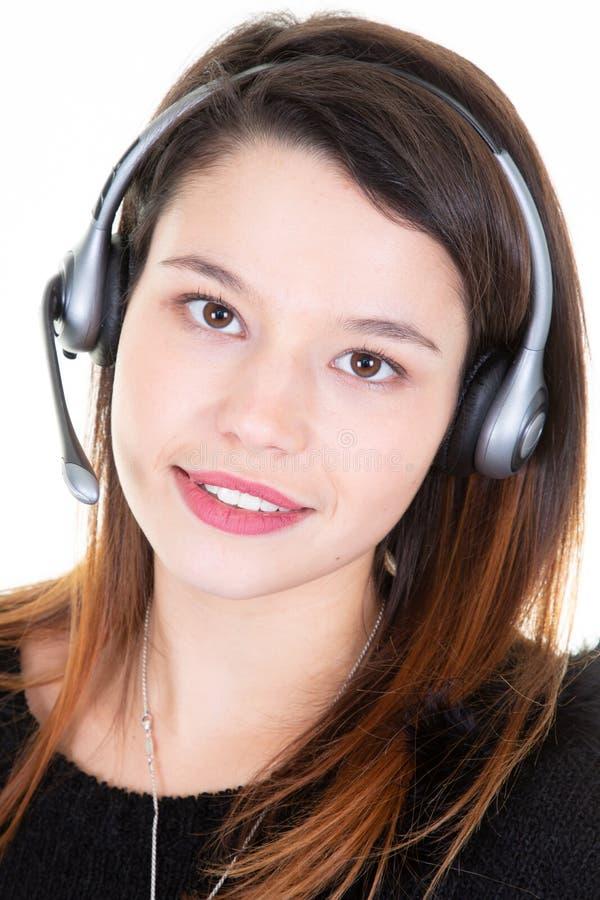 Telemarketing girl operator on white background. A Telemarketing girl operator on white background royalty free stock photo
