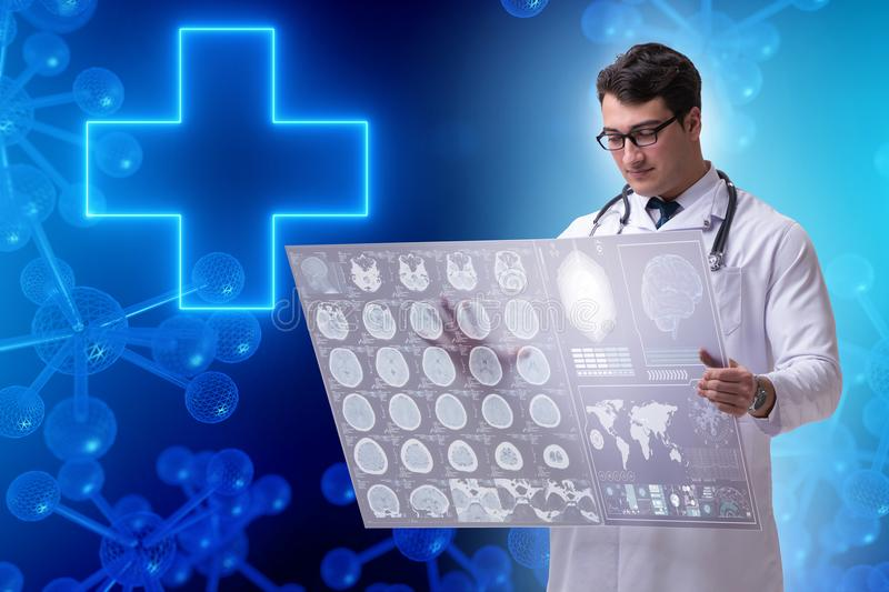 The telemedicine concept with doctor looking at x-ray image. Telemedicine concept with doctor looking at x-ray image stock photography