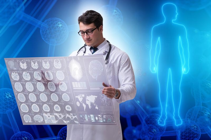 The telemedicine concept with doctor looking at x-ray image. Telemedicine concept with doctor looking at x-ray image stock photo