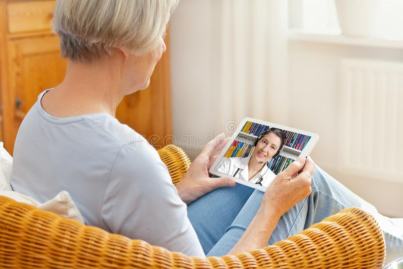 Telemedicine senior woman tablet computer stock photography
