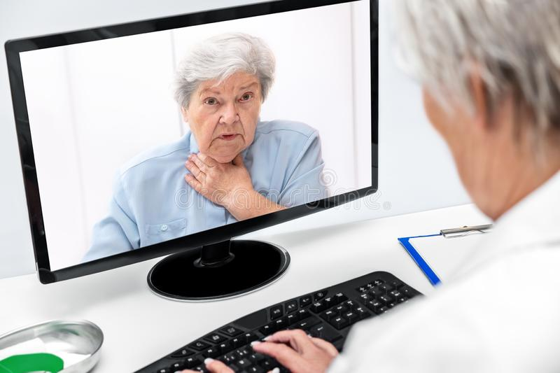 Telemedicine and eHealth with a elderly woman and a female doctor royalty free stock images