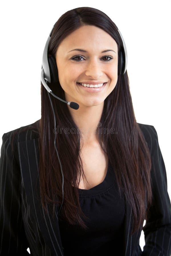 Teleoperador hispánico hermoso feliz de la hembra del negocio imagenes de archivo