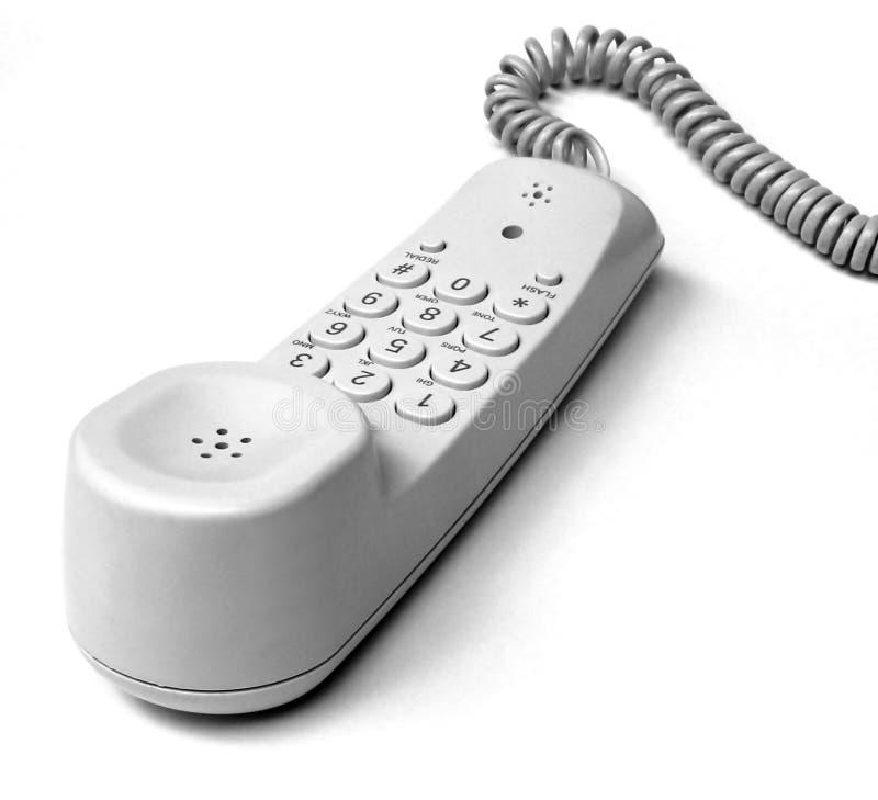Telephone. A white telephone against white background
