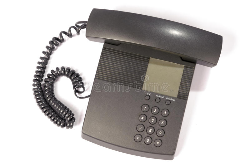 Telephone. Black modern telephone isolated on a white background royalty free stock photography