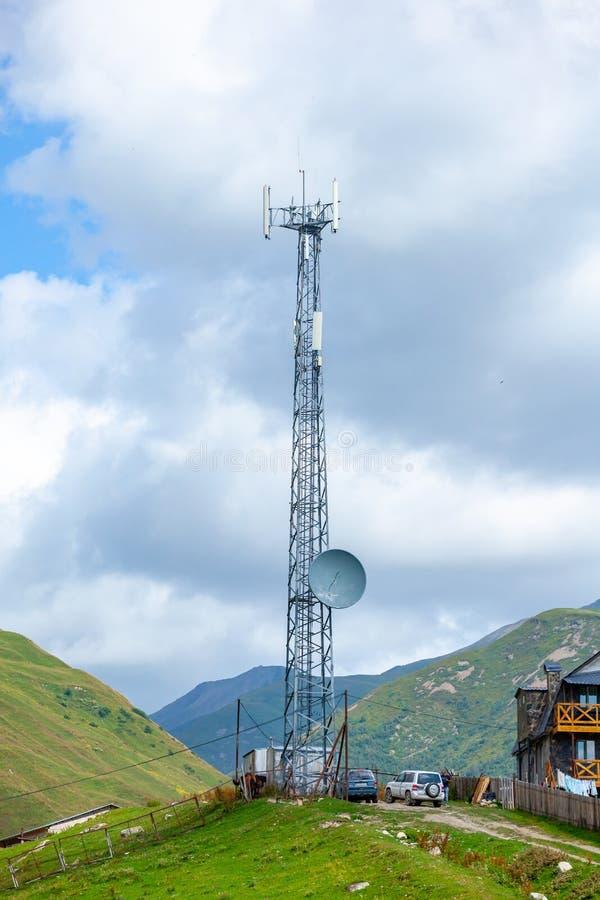 Telephone antenna, blue sky and white clouds in Ushguli, Svaneti, Georgia stock images