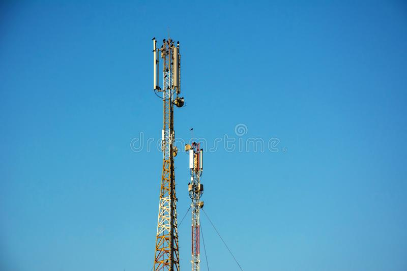 Telephone antenna under clear blue sky. Telephone antenna on clear blue sky background. Sunny day. 4G and 4.5G Cell site, Telecom radio tower or mobile phone royalty free stock photos