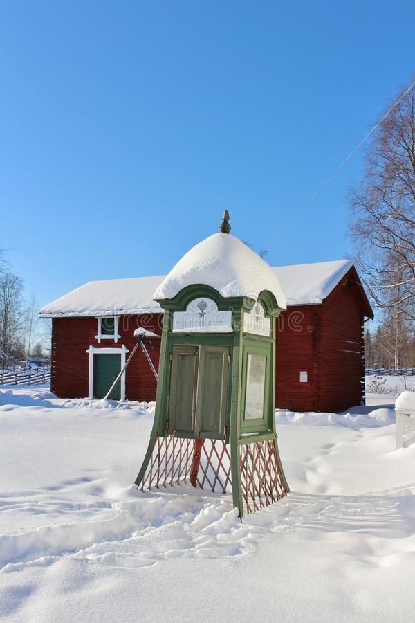 Telephone booth in open-air museum Hägnan. Hägnan is a cultural and historical center of knowledge in Gammelstad. The museum has buildings from the 1700s stock photos