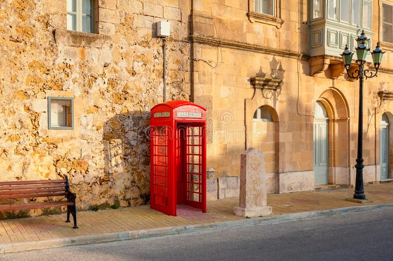Telephone Booth in Street of Gozo Malta royalty free stock photos