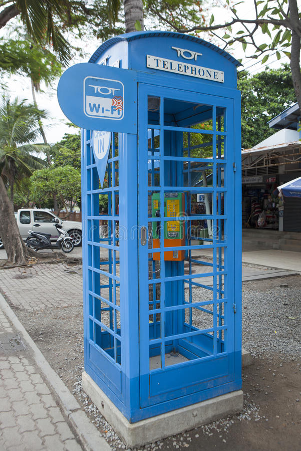 Telephone booth and wi-fi pot of TOT. Pattaya, Thailand - Jul 17, 2015: Close up of a telephone booth and wi-fi pot of TOT on a street. TOT Public Company stock images