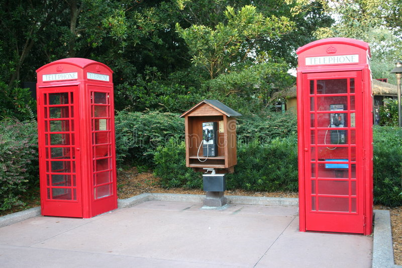 Telephone booths. Two red public telephone booths stock image