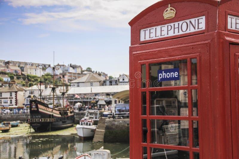 Telephone Box in Brixham Harbour, Devon. Traditional British Red telephone box taken in Brixham Harbour on the British Riviera in Devon stock photo