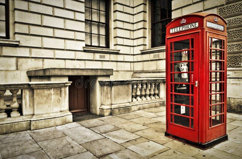 Telephone box in London. Classic red British telephone box in London stock photos