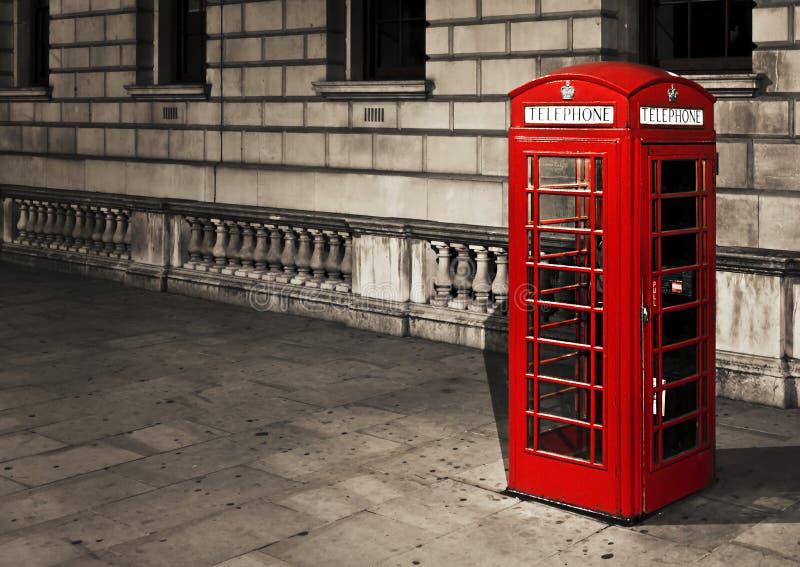 Telephone box in London. Classic red British telephone box in London royalty free stock photo