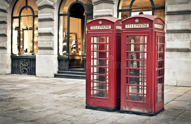 Telephone box in London. Classic red British telephone boxes in London stock photos