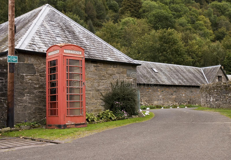 Telephone Box By Road Stock Photo