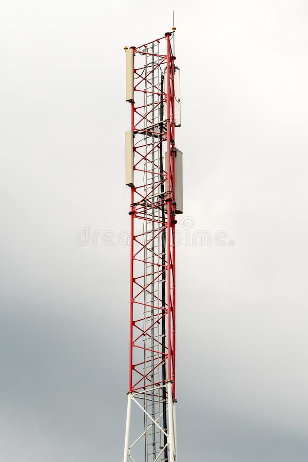 Telephone or cellphone communication pole. With cloudy sky background royalty free stock photography