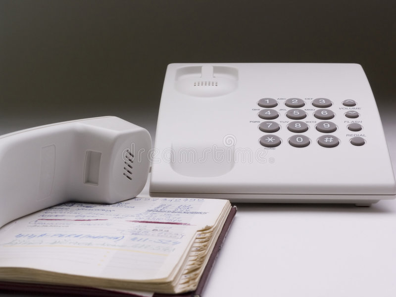 Telephone and directory. Telephone and pocket directory isolated stock photos