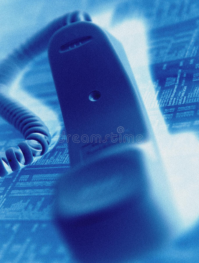 Telephone handset on financial page. Telephone handset on newspaper financial page royalty free stock image