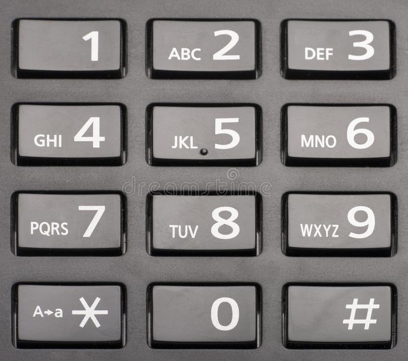 Telephone keypad with rectangular buttons close up. Limited depth of field stock photos
