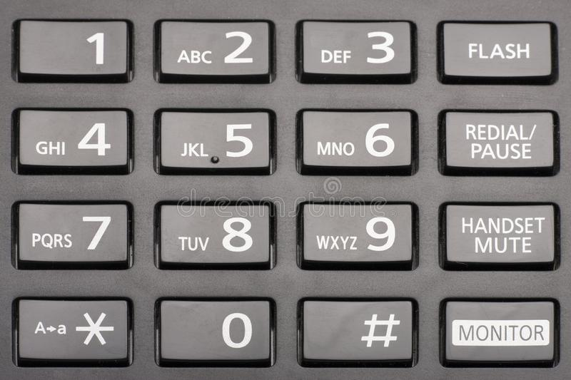 Telephone keypad with rectangular buttons close up. Limited depth of field royalty free stock photography