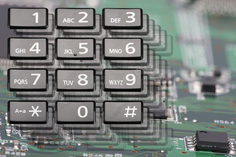 Telephone keypad with rectangular buttons close up. Limited depth of field stock images