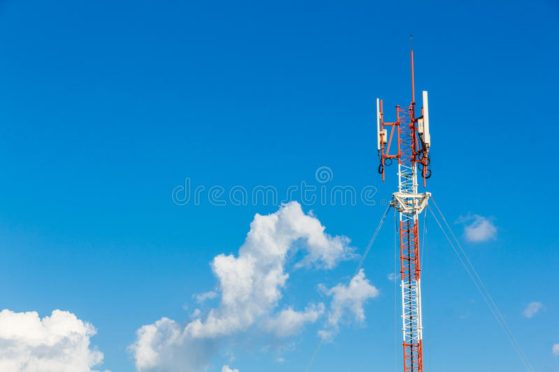 Telephone mast on Blue sky. With big clouds and free space for your text stock photography