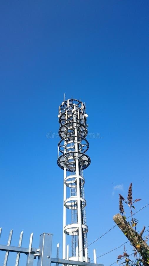 Telephone mast. Telephone, communication mast with blue sky background stock image