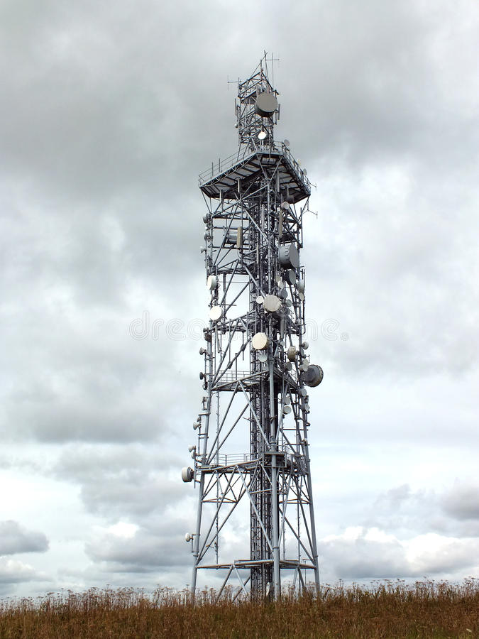 Telephone Mast. Or communications tower with cloudy sky behind stock photo