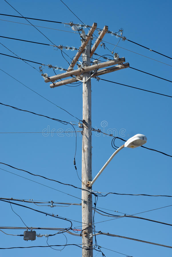 Telephone Pole. Wooden Telephone Pole with Power Lines and Light royalty free stock photo
