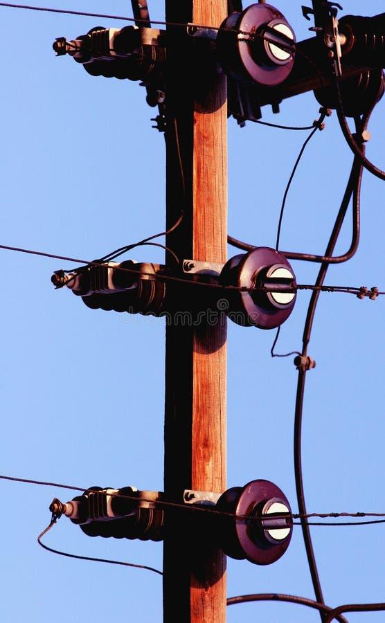 Telephone pole. Against a blue sky stock photos