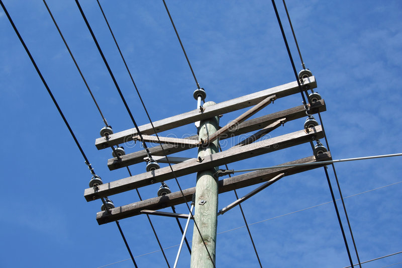Telephone Pole. A Telephone Pole against a blue sky stock image