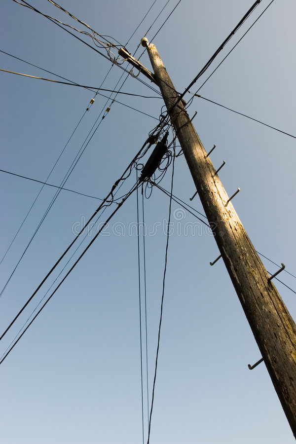Telephone pole. A telephone pole and power lines royalty free stock image