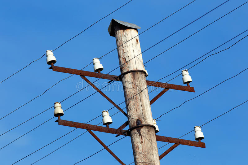 Telephone pole. Close-up of a telephone pole with bare wires royalty free stock images