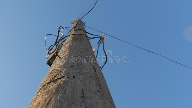 Telephone poles around the wires stock images