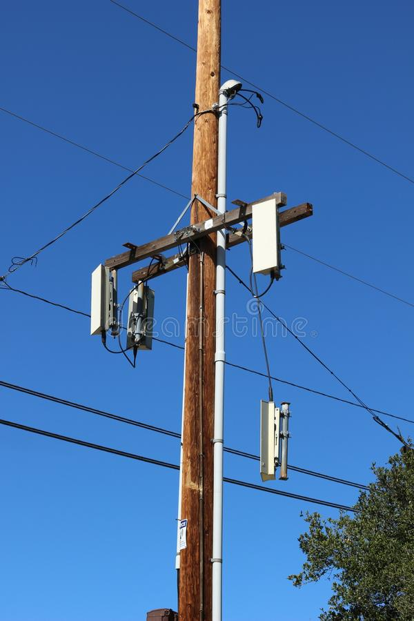 Telephone pole. A telephone pole with a broken object dangling royalty free stock images