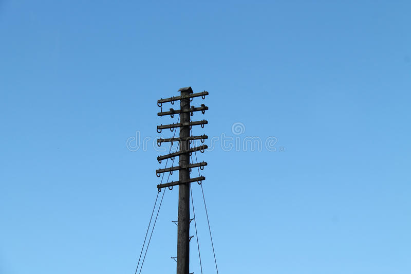 Telephone Pole. A Vintage Wooden Pole for Holding Telephone Wires royalty free stock image