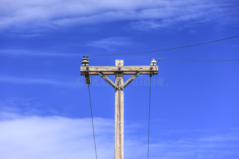 Telephone pole and wires. Conceptual image of telephone pole and wires against a blue sky royalty free stock photos