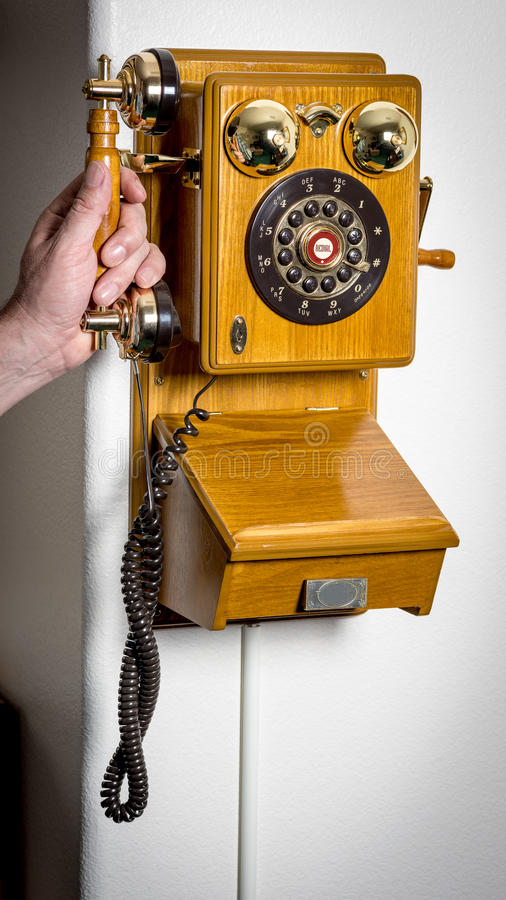 Telephone push botton with bells made of wood royalty free stock image