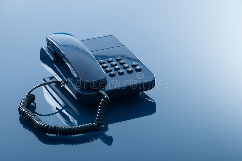Telephone set. Old fashioned telephone with reflection isolated on transparent blue background stock photography