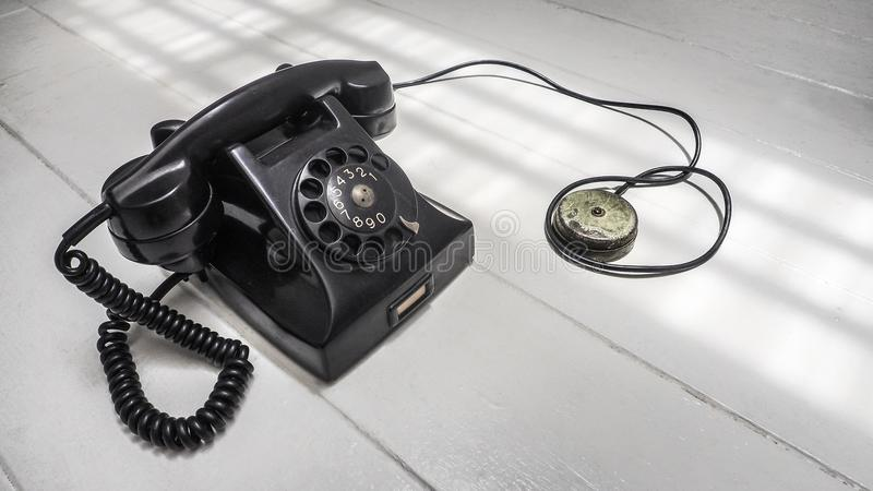 Telephone set antique black color dial system communication. Isolate on white wood floor has copy space stock photography